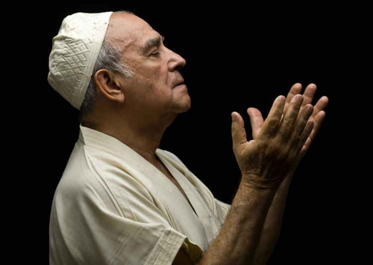 Muslim man praying.