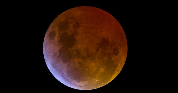 A totally eclipsed Moon against a black night sky