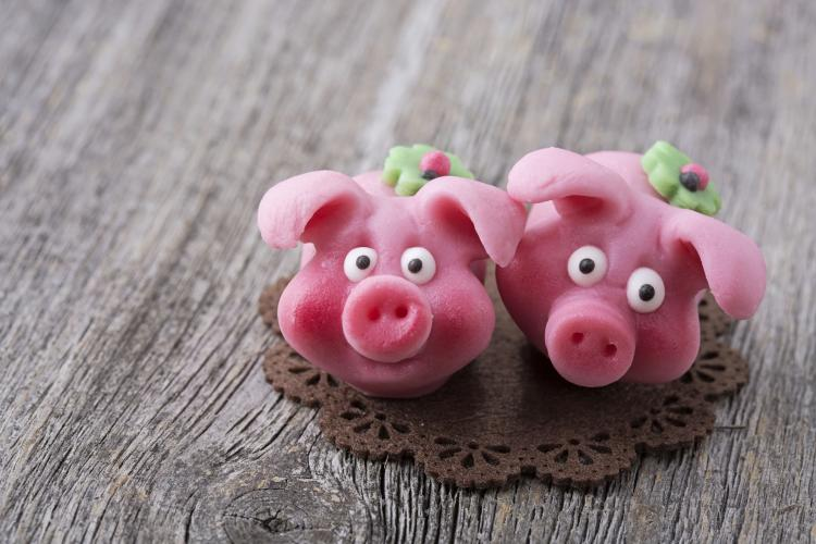 Close-up of two pink marzipan pigs.