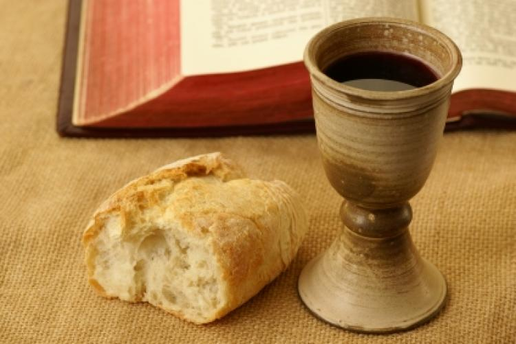 Image showing bread and a cup of wine to depict the Last Supper