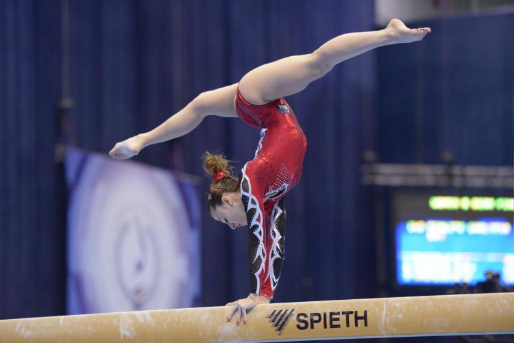 Italian athlete Carlotta Ferlito, performs on the balance beam in the 5th European Championships in Artistic Gymnastics in Moscow, Russia on April 21, 2013.