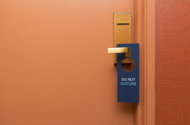 Do not disturb sign on a hotel door.
