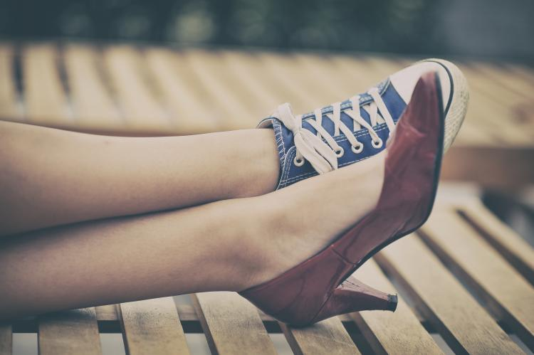 Woman wearing two different shoes.