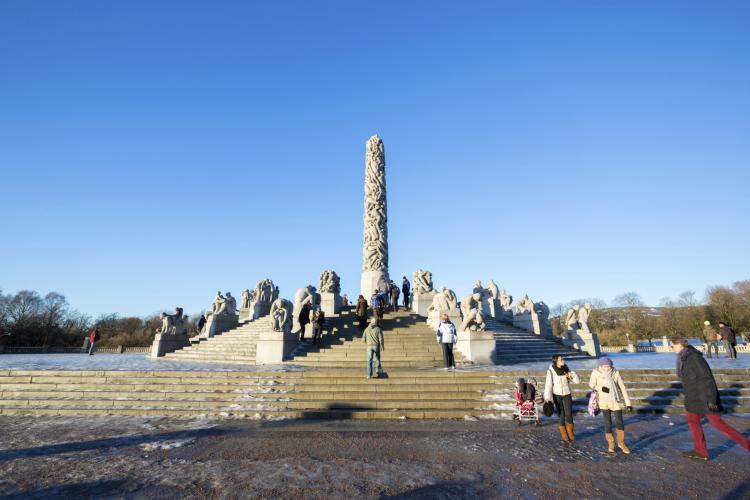 People walking by the Monolith statue in Frogner Park in Oslo on January 1.