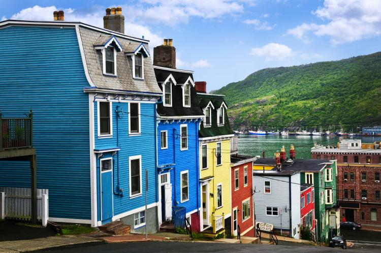 Street with colorful houses near the ocean in St. Johns, Newfoundland, Canada