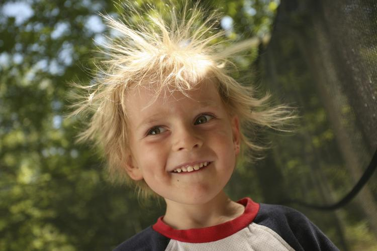 Boy with static hair sticking out.