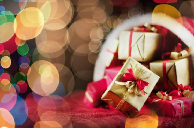 Where did the practice of gift giving at christmas originate