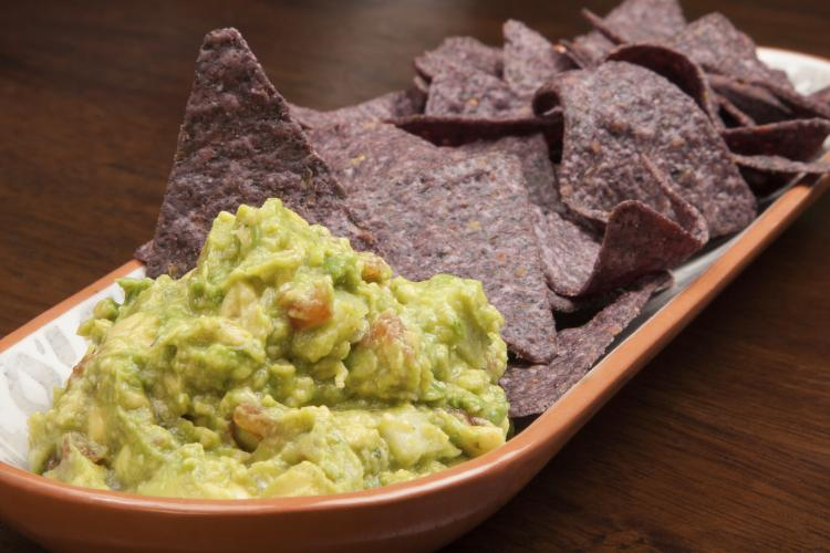 Tortilla chips and guacamole.