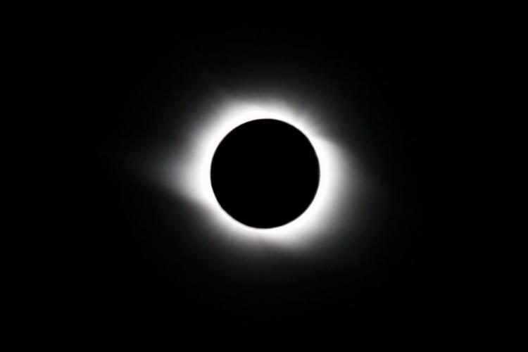image of totally eclipsed or blacked out Sun showing only light from the corona