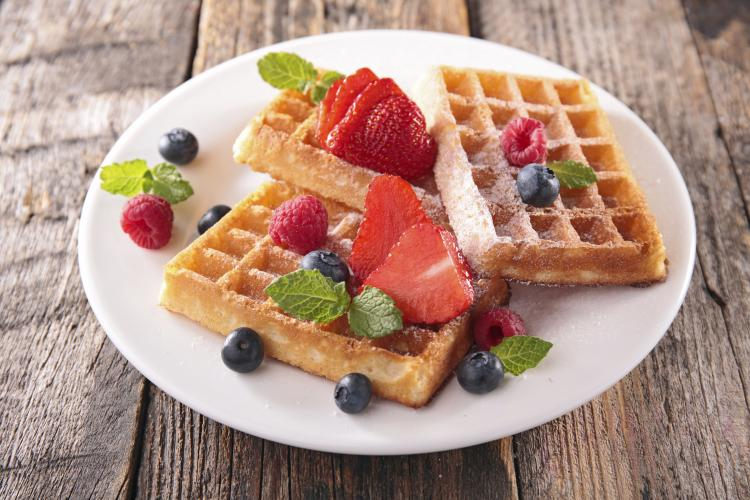 Waffles with strawberries and blueberries.