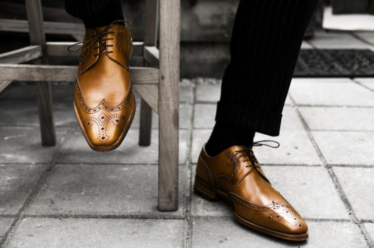 Man wearing fancy brown shoes.