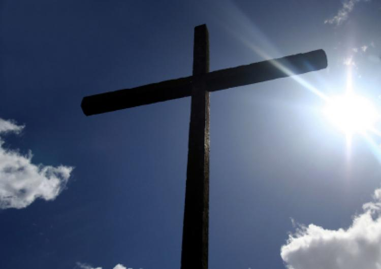 Humble Wooden Cross with Bright Sunburst