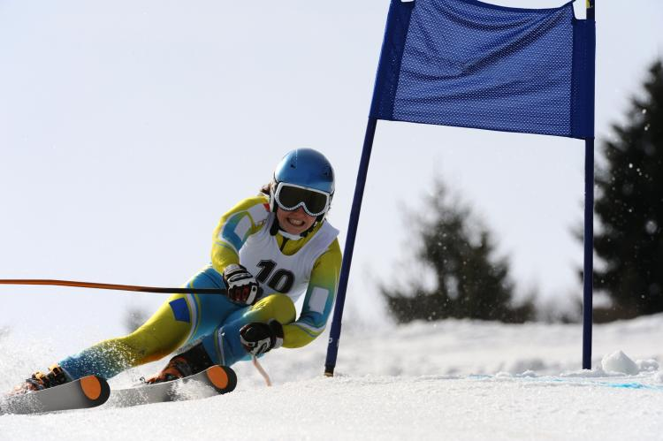 Portrait of young female skier during giant slalom race