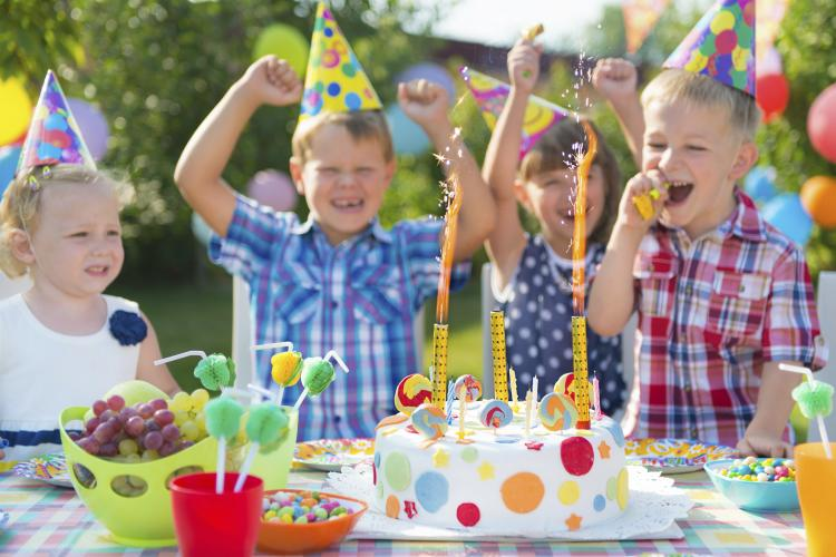 Group of kids having fun at a birthday party.