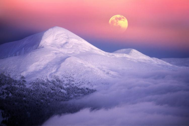 Moonrise over alpine peaks in Utah.