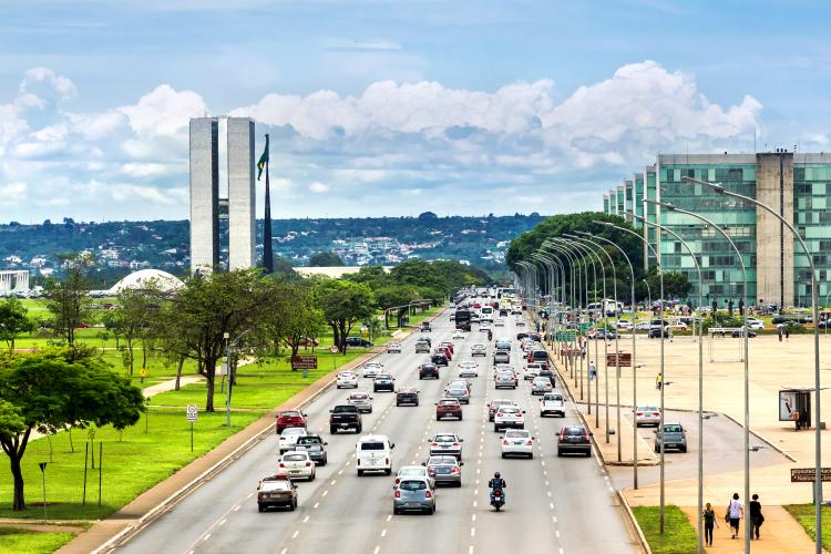 View of traffic on street next to Congresso Nacional (National Congress) building in Brasilia, capital of Brazil.