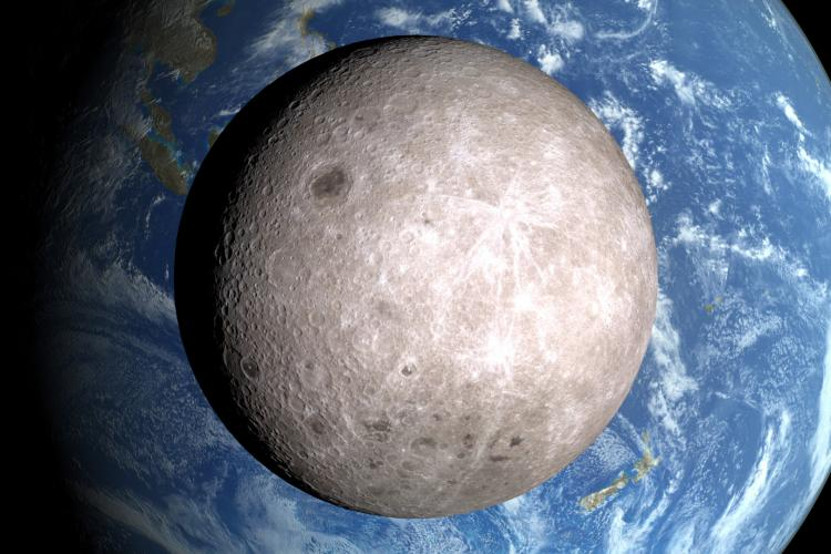 Close-up of the far side of the Moon with partial Earth in the background.