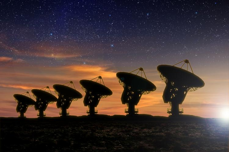 Radio telescopes at night.