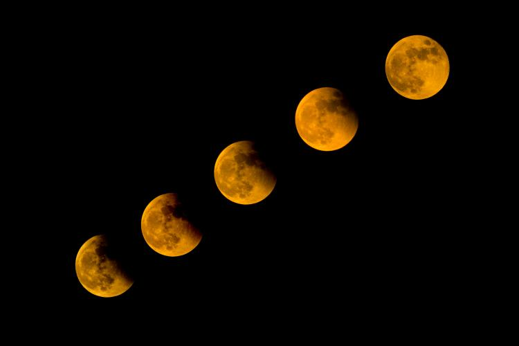 A Total Lunar Eclipse happens when the Earth moves in between the Sun and the Moon.