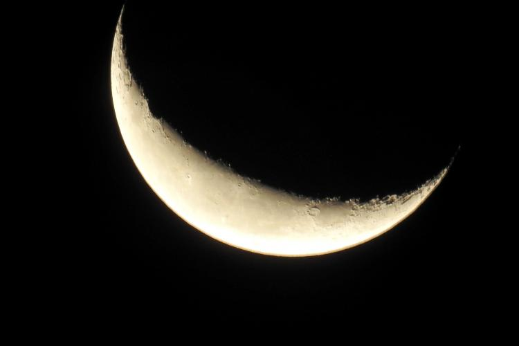 Waning Crescent Moon against a black night sky