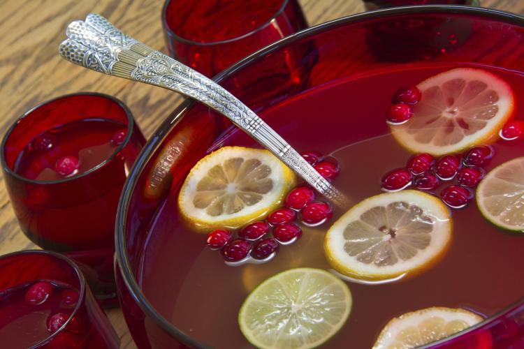 Punch bowl with cranberry punch.