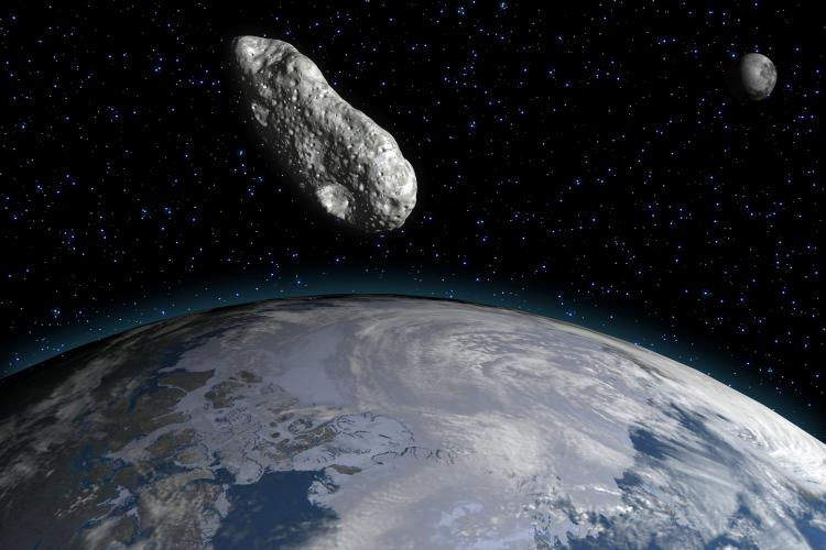 A 3-D rendering of an asteroid and the Earth by an artist.