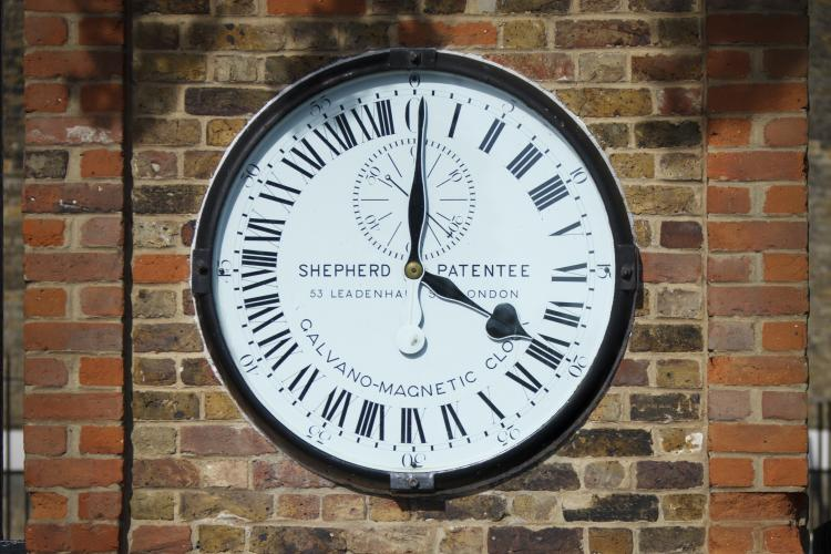 History of time zones in the uk the shepherd gate clock on the wall at the royal observatory greenwich gumiabroncs Images