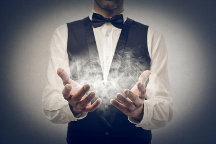 A magician with smoke in his hands.