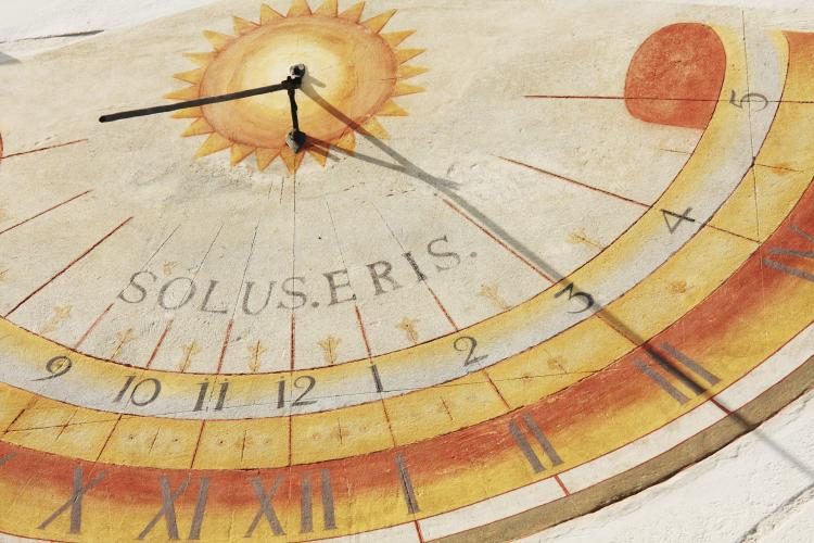 A sundial with the Sun casting a shadow.