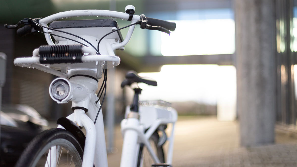 Close-up of a white electric city bike.