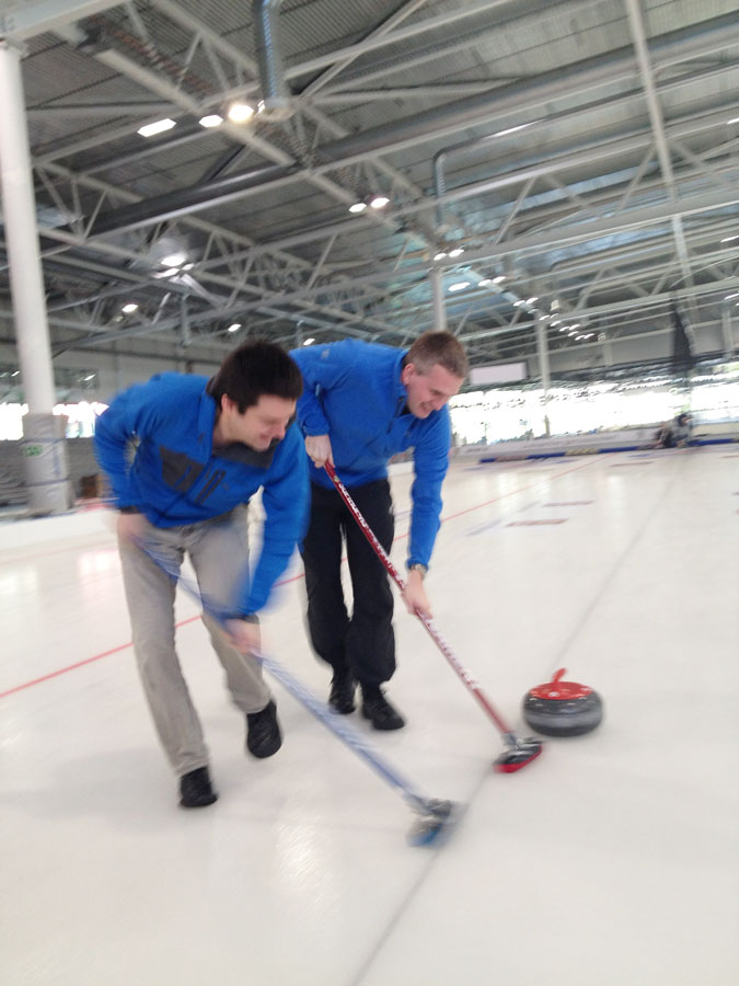 Employees curling during team building