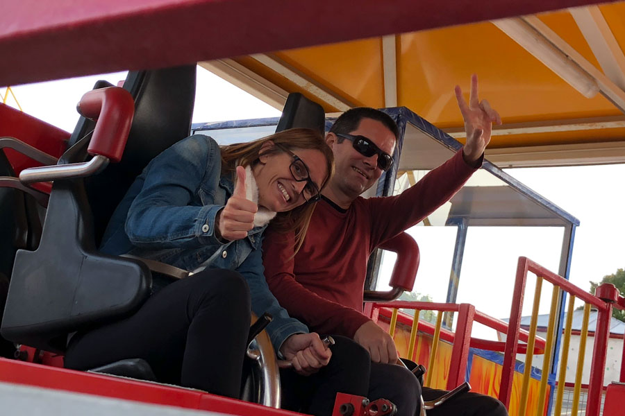 A man and a woman on a roller coaster