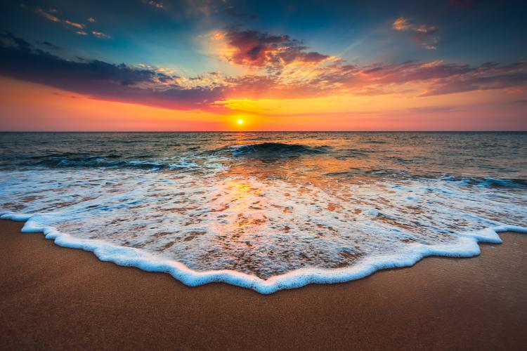 Image of sunset on a beach.