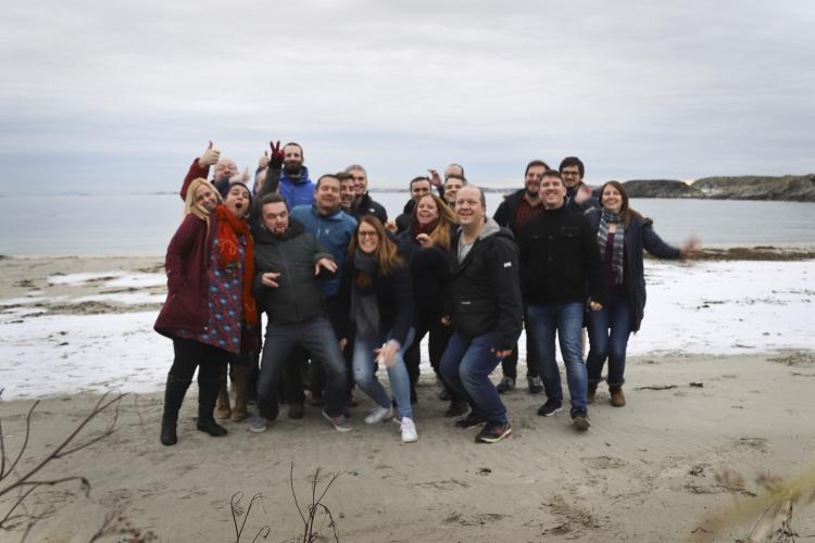 Picture of the timeanddate staff on a beach.