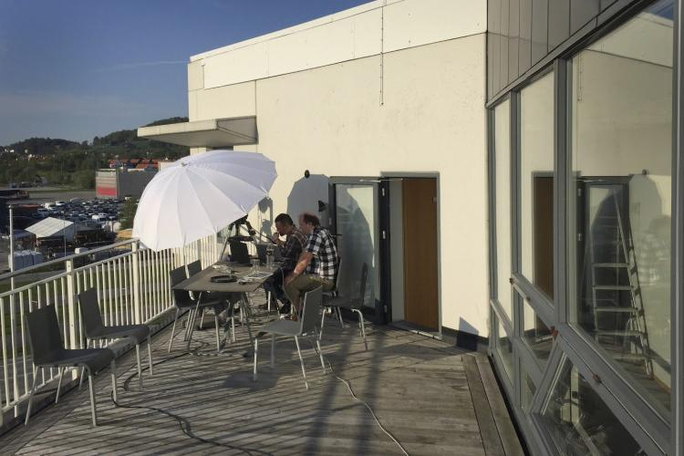 Image of timeanddate employees streaming an eclipse from the office balcony.